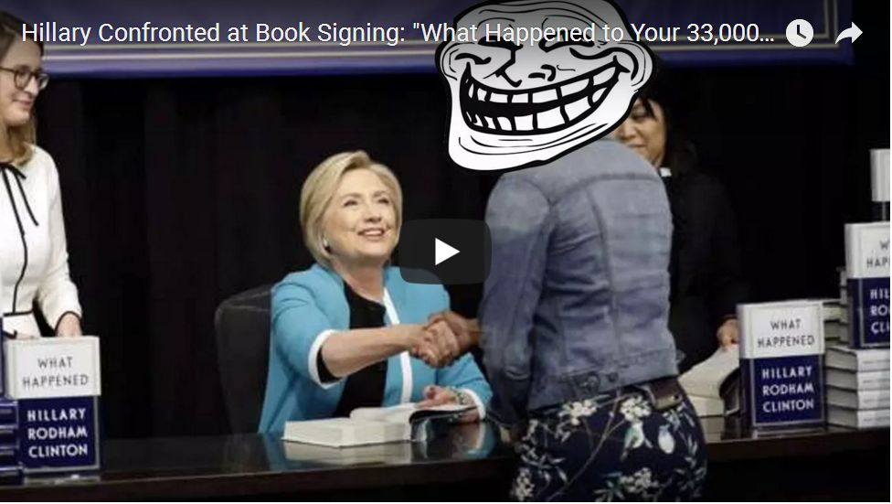 HILLARY CONFRONTED AT BOOK SIGNING