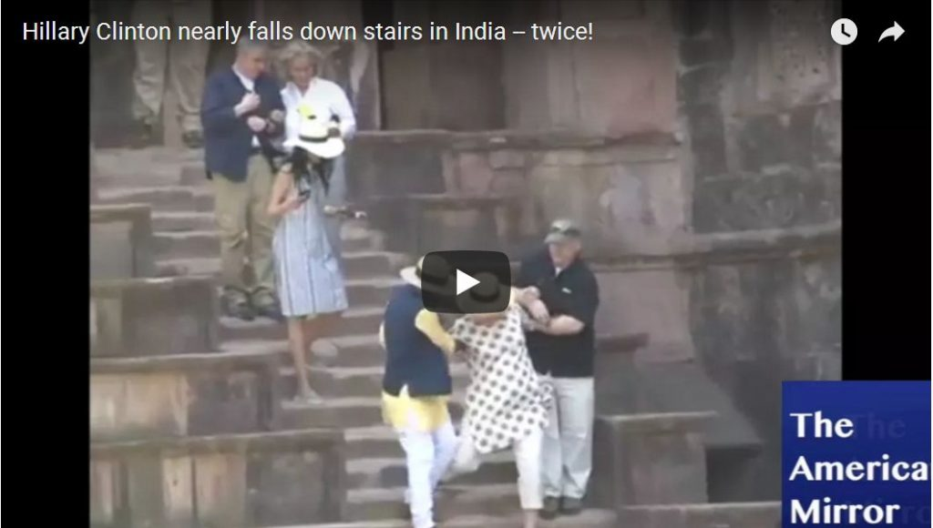 Feeble Hillary STUMBLES Walking Down Stairs…