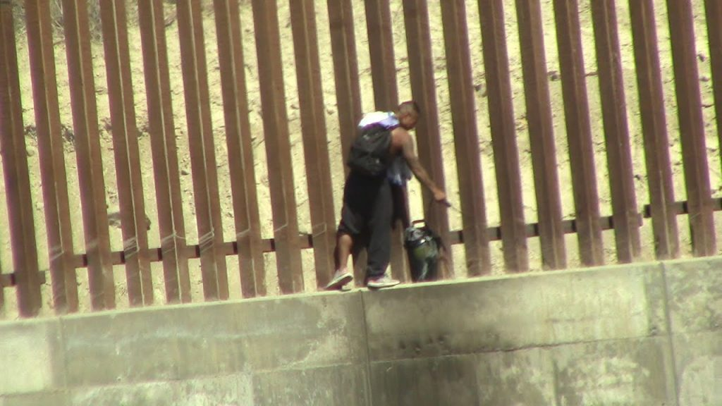 Why is this Mexican spraying the new Border Wall in Tijuana?